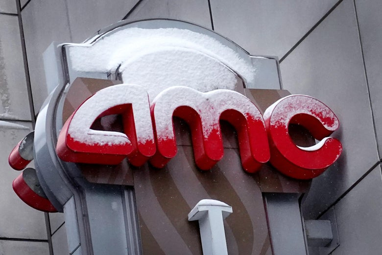 Snow-covered AMC sign outside a movie theater