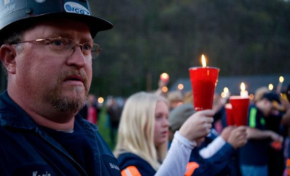 Local coal miner Kevin Honaker participate in a candle light vigil held for the deceased coal miners.