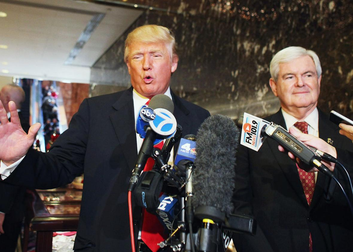 Donald Trump Republican presidential candidate speaks to the media as former Speaker of the House Newt Gingrich listens at Trump Tower following a meeting between the two on December 5, 2011 in New York City.