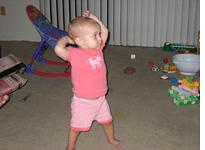 Our baby daughter seems undaunted by our bleak new apartment          Click on image to enlarge.