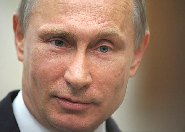Russia's President Vladimir Putin talks to reporters after a session of the Supreme Eurasian Economic Council.
