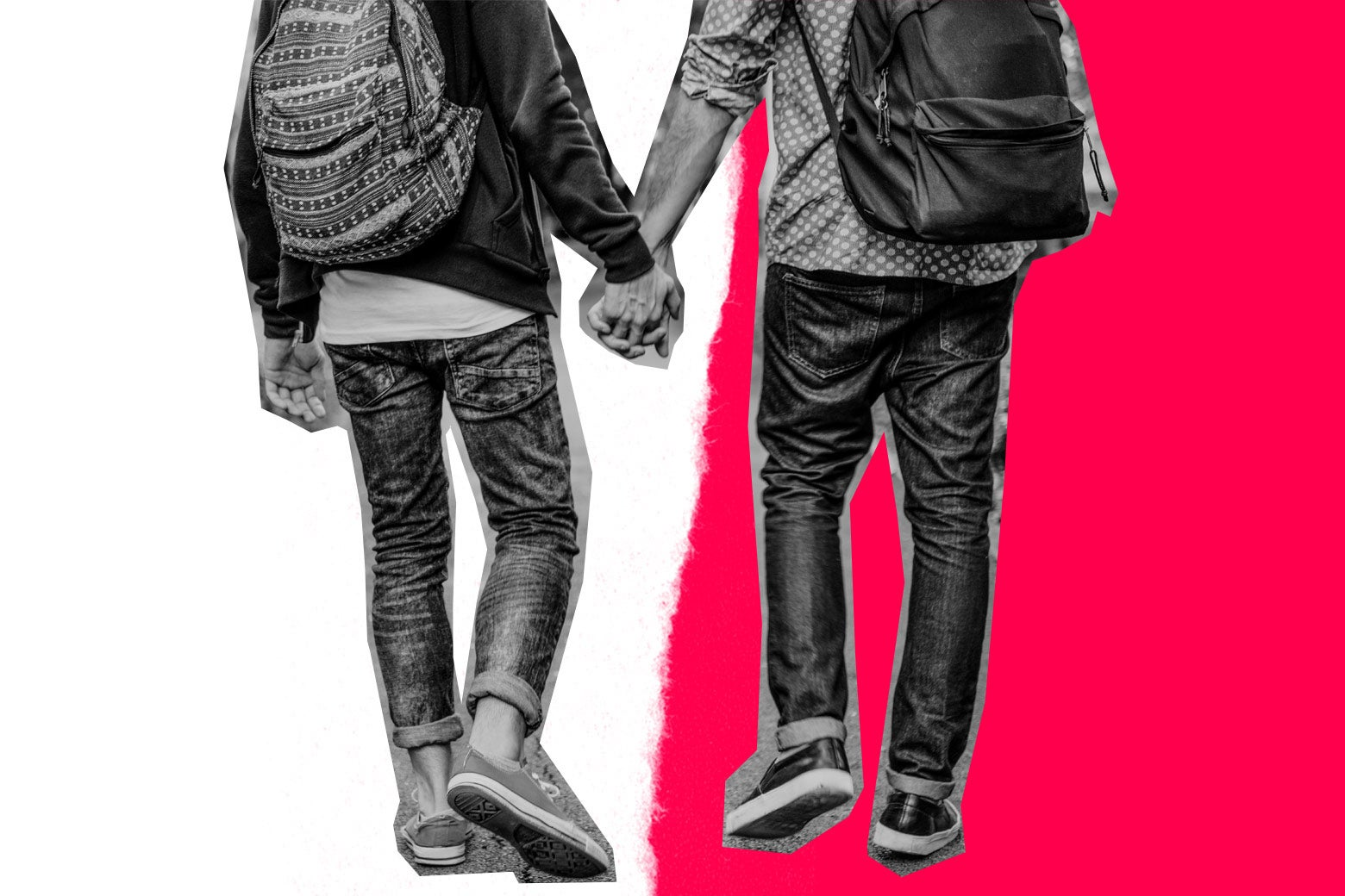 Two people wearing backpacks hold hands.