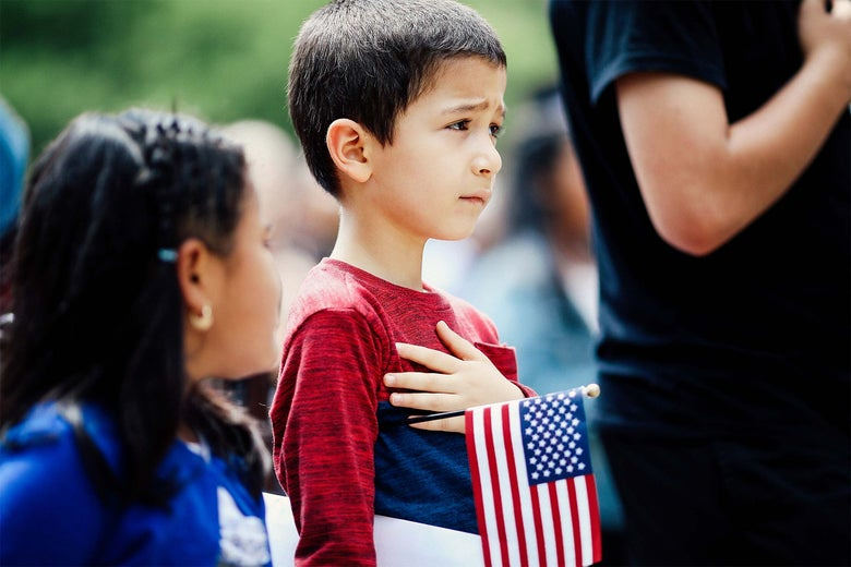 Children take the say the Pledge of Allegiance during a children's citizenship ceremony hosted by Citizenship and Immigration Services on May 31 in Washington.