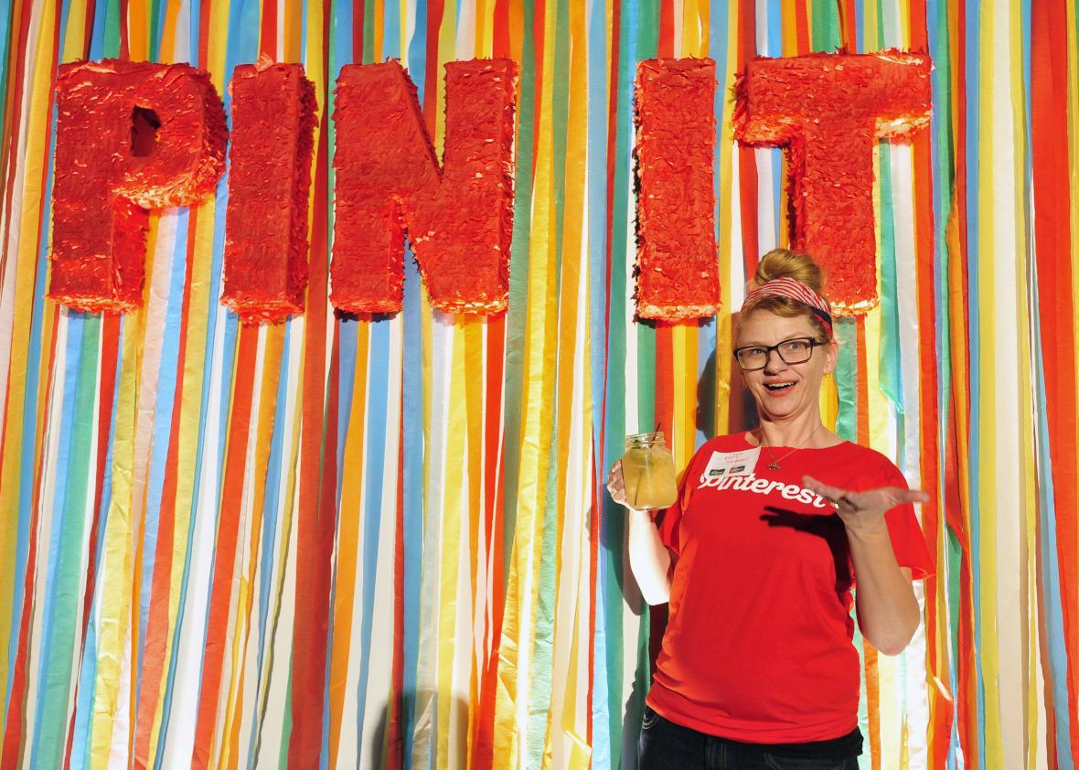 A Pinterest employee poses for a photo during a media event in San Francisco on April 24, 2014