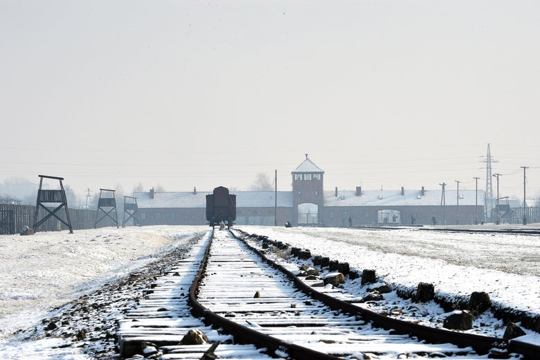 View of the rail way tracks at the former Nazi concentration camp Auschwitz-Birkenau in Oswiecim, Poland, on Holocaust Day, January 27, 2014. The ceremony took place 69 years after the liberation of the death camp by Soviet troops, in rememberance of the victims of the Holocaust. AFP PHOTO/JANEK SKARZYNSKI        (Photo credit should read JANEK SKARZYNSKI/AFP/Getty Images)