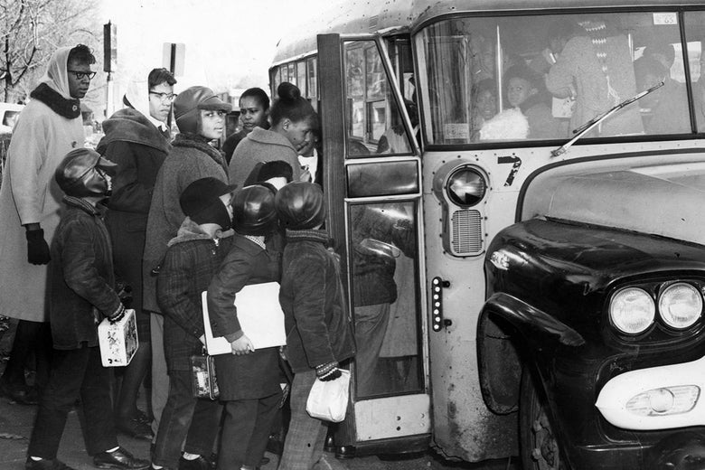 Black students board a school bus in Massachusetts.