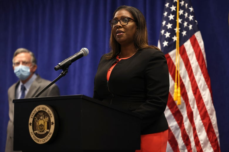 Letitia James stands at a podium with an American flag backdrop.