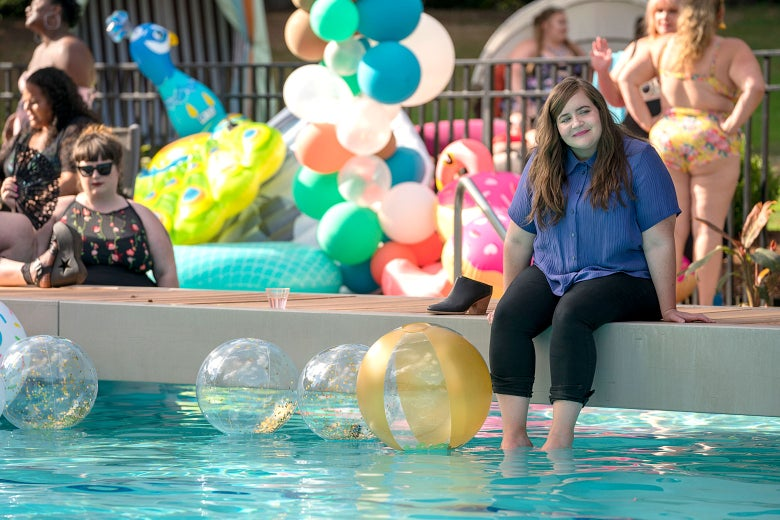Aidy Bryant sitting poolside at a party in Shrill.