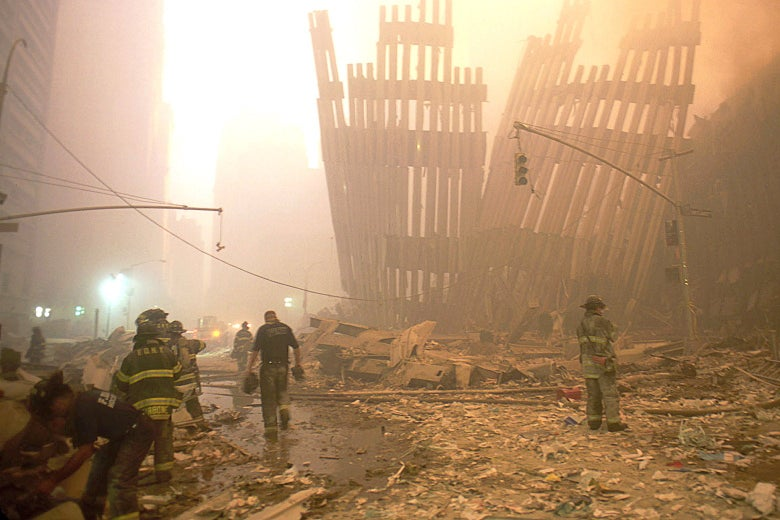 Rescue crews engulfed in a fog of dust set in the World Trade Center rubble