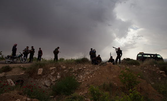 Syrian rebels take position near Qusayr, 15 kms (nine miles) from the flashpoint city of Homs, on May 10, 2012.
