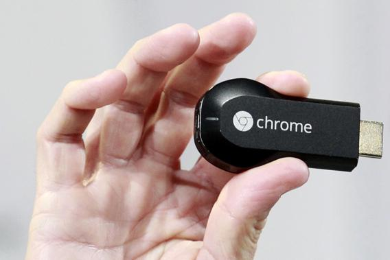 Mario Queiroz, vice president of product management, holds the new Google Chromecast dongle as it is announced during a Google event at Dogpatch Studio in San Francisco, California, July 24, 2013.