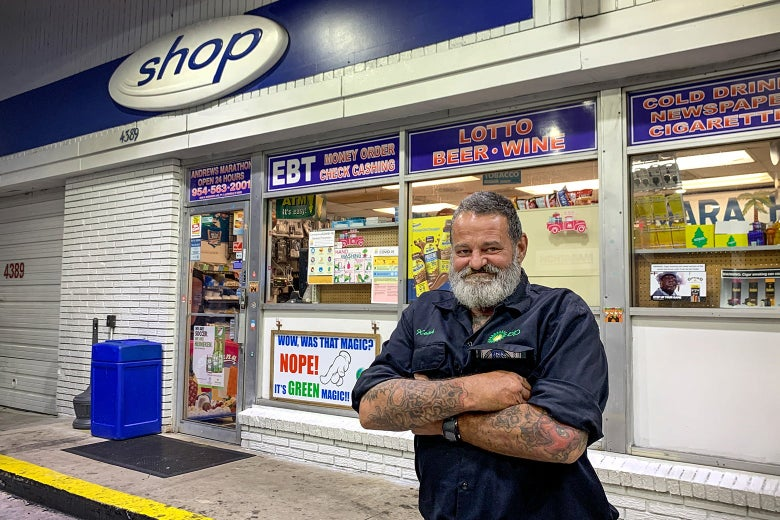 John Scammon stands in front of a gas station convenience store.