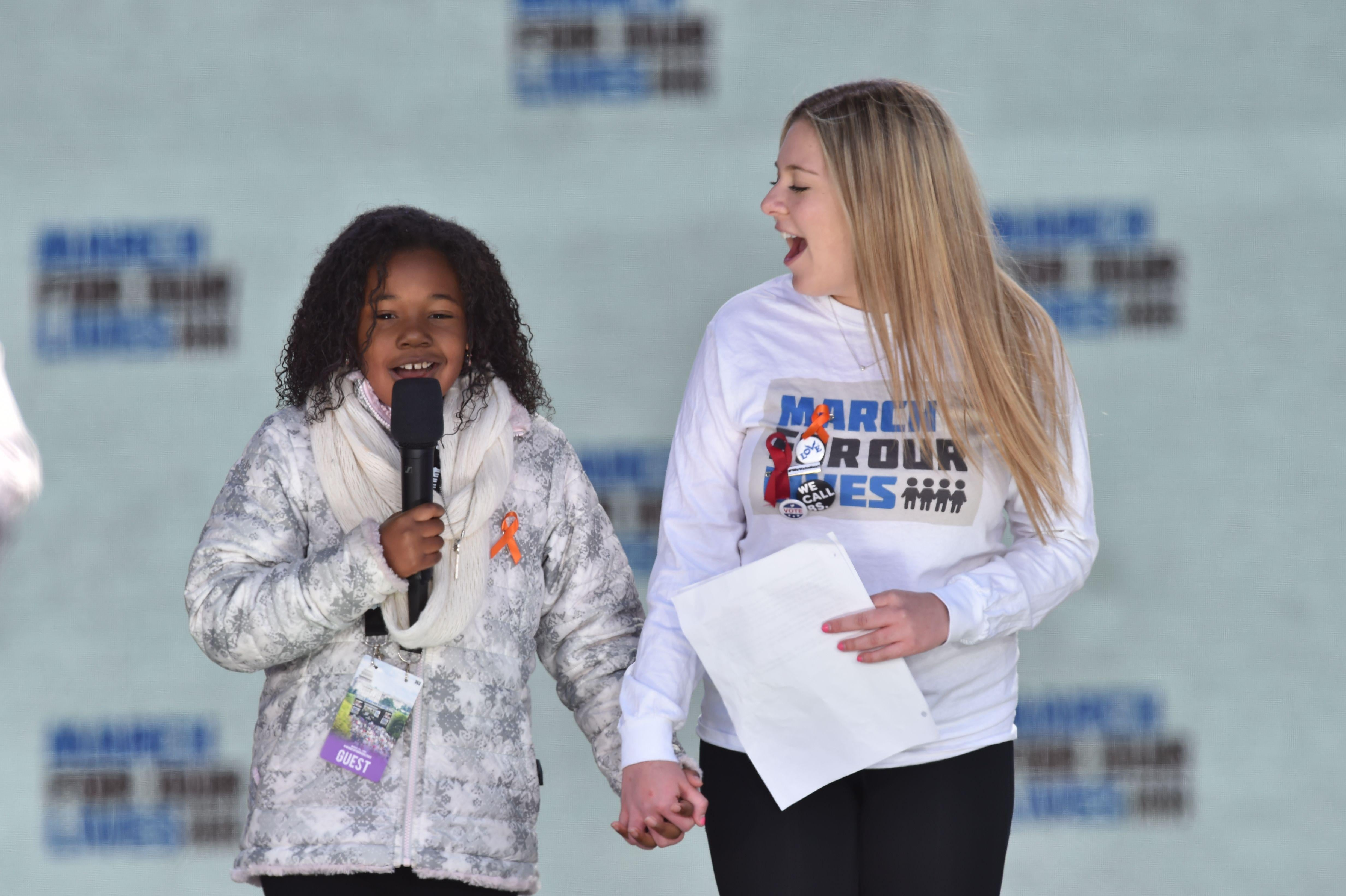 Martin Luther King Jr's granddaughter Yolanda Renee King speaks next to student Jaclyn Corin during the March for Our Lives Rally in Washington, D.C. on March 24, 2018.