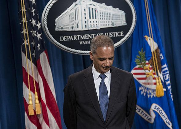 US Attorney General Eric H. Holder Jr. listens to question during a press conference at the Department of Justice .