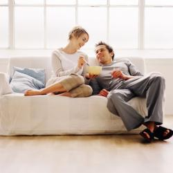 Happy couple sitting on a couch.