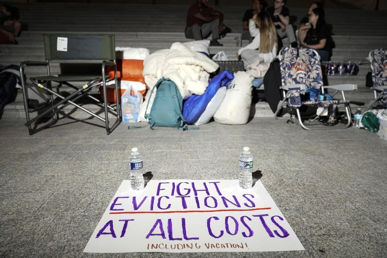 A sign calling for fighting evictions is set on the ground as Rep. Cori Bush (D-MO) spends the night outside the U.S. Capitol to call for for an extension of the federal eviction moratorium on July 31, 2021 in Washington, D.C.