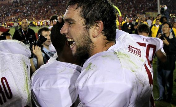 Quarterback Andrew Luck #12 of the Stanford Cardinal celebrates with teammates.