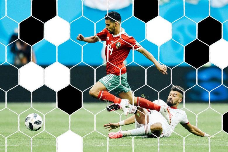 Grass flies as Manuel da Costa of Morocco is fouled by Ramin Rezaeian of Iran.