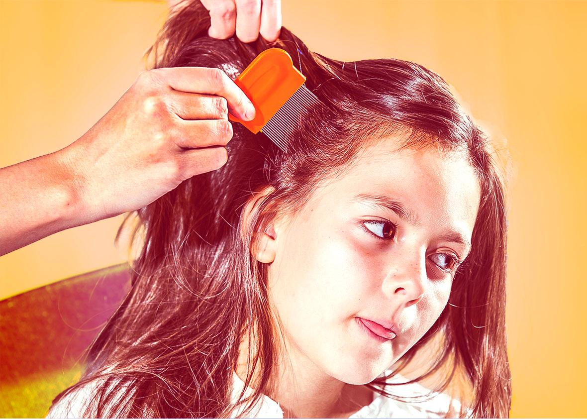 Mother using a comb to look for head lice.