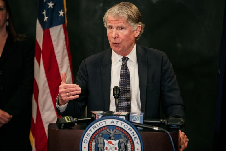 Cy Vance speaks at a branded lectern in front of a U.S. flag.