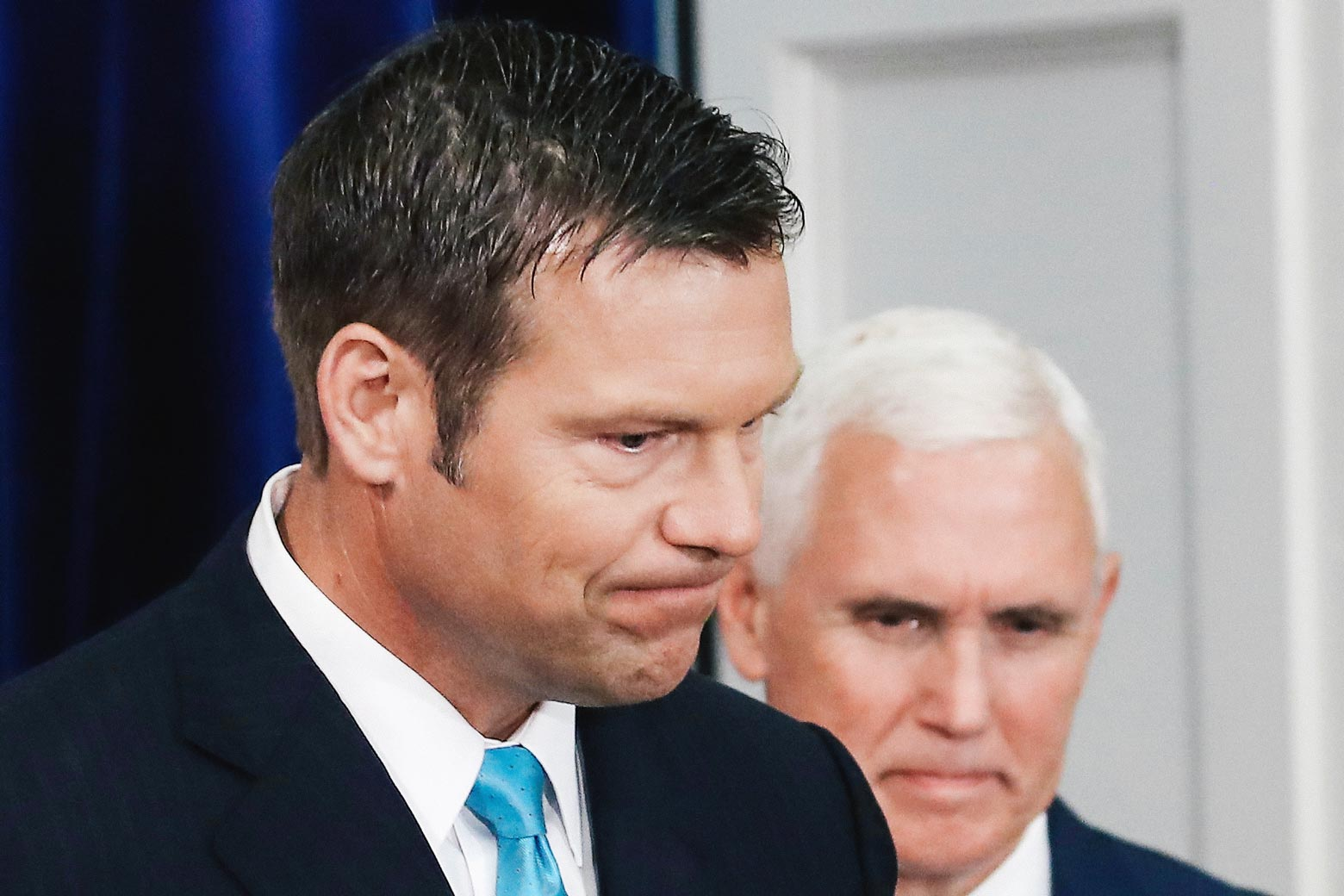 Kansas Secretary of State, Kris Kobach (L) and US Vice President Mike Pence, attend the first meeting of the Presidential Advisory Commission on Election Integrity in the Eisenhower Executive Office Building, on July 19, 2017 in Washington, DC.