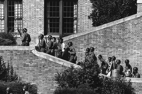 Soldiers from the 101st Airborne Division escort the Little Rock Nine students into the all-white Central High School in Little Rock, Ark., in 1957.