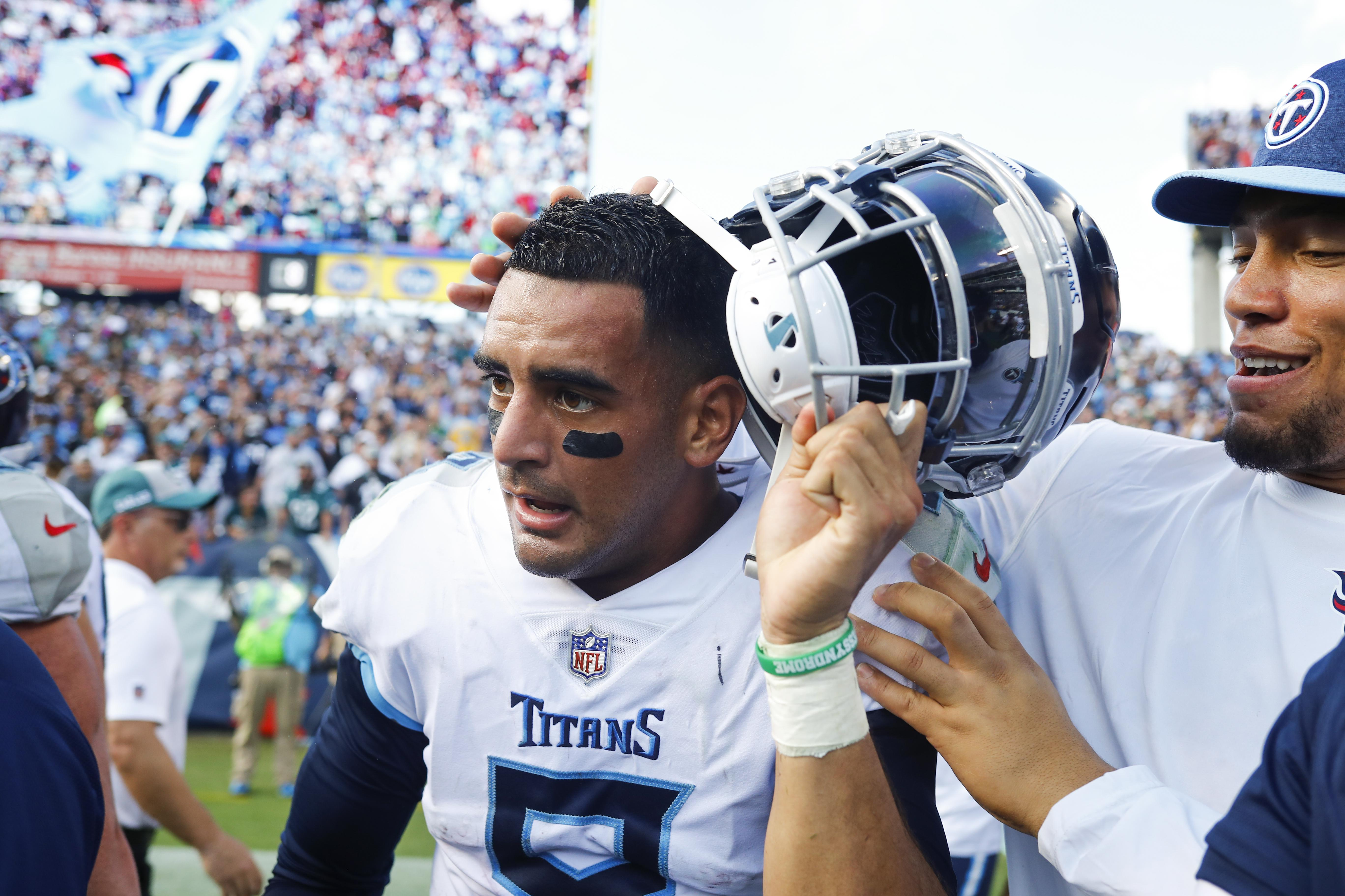 NASHVILLE, TN - SEPTEMBER 30: Marcus Mariota #8 of the Tennessee Titans is congratulated as he removes his helmet after defeating the Philadelphia Eagles 26-23 in overtime at Nissan Stadium on September 30, 2018 in Nashville, Tennessee. (Photo by Wesley Hitt/Getty Images)