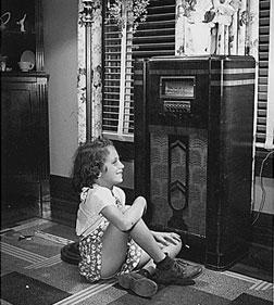 A girl listening to the radio during the Great Depression. Click image to expand.