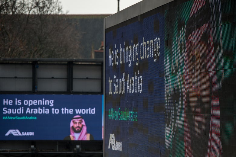 Electronic billboards show adverts for Saudi Crown Prince Mohammed bin Salman with the hashtag '#ANewSaudiArabia' on March 7, 2018 in London, England.