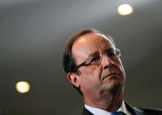 French President Francois Hollande visits the IXBlue company in Marly-le-Roi near Paris.