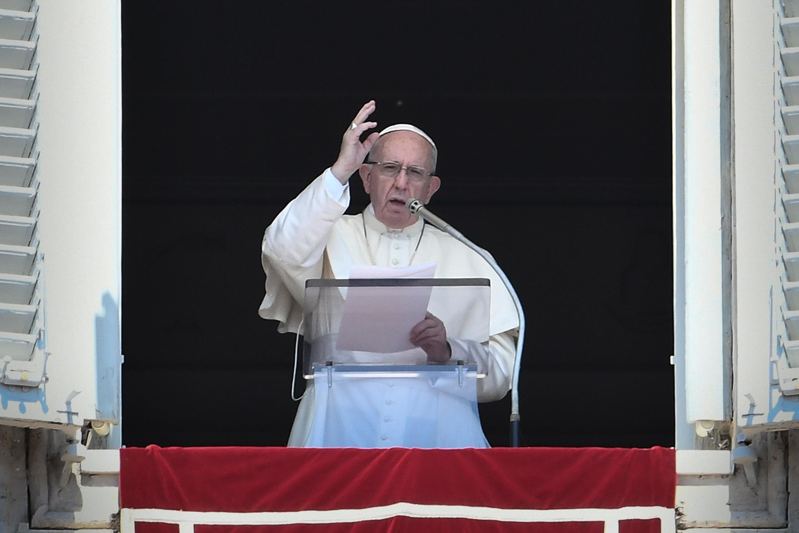 Pope Francis speaks from a window of the Apostolic Palace at St. Peter's Square in the Vatican.