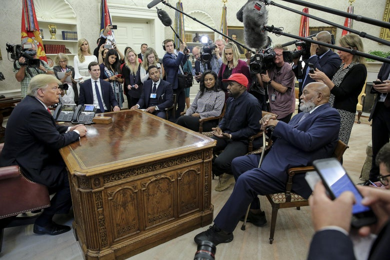 Rapper Kanye West, second right, flanked by NFL Hall of Famer Jim Brown, right, speaks during a meeting with President Donald Trump, left, in the Oval office of the White House on October 11, 2018 in Washington, DC. Next to Trump, Ivanka Trump and Senior Advisor to the President, Jared Kushner.