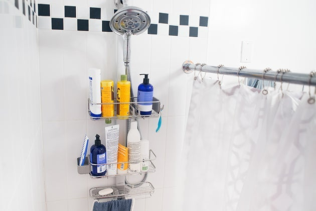Shower caddy filled with products.