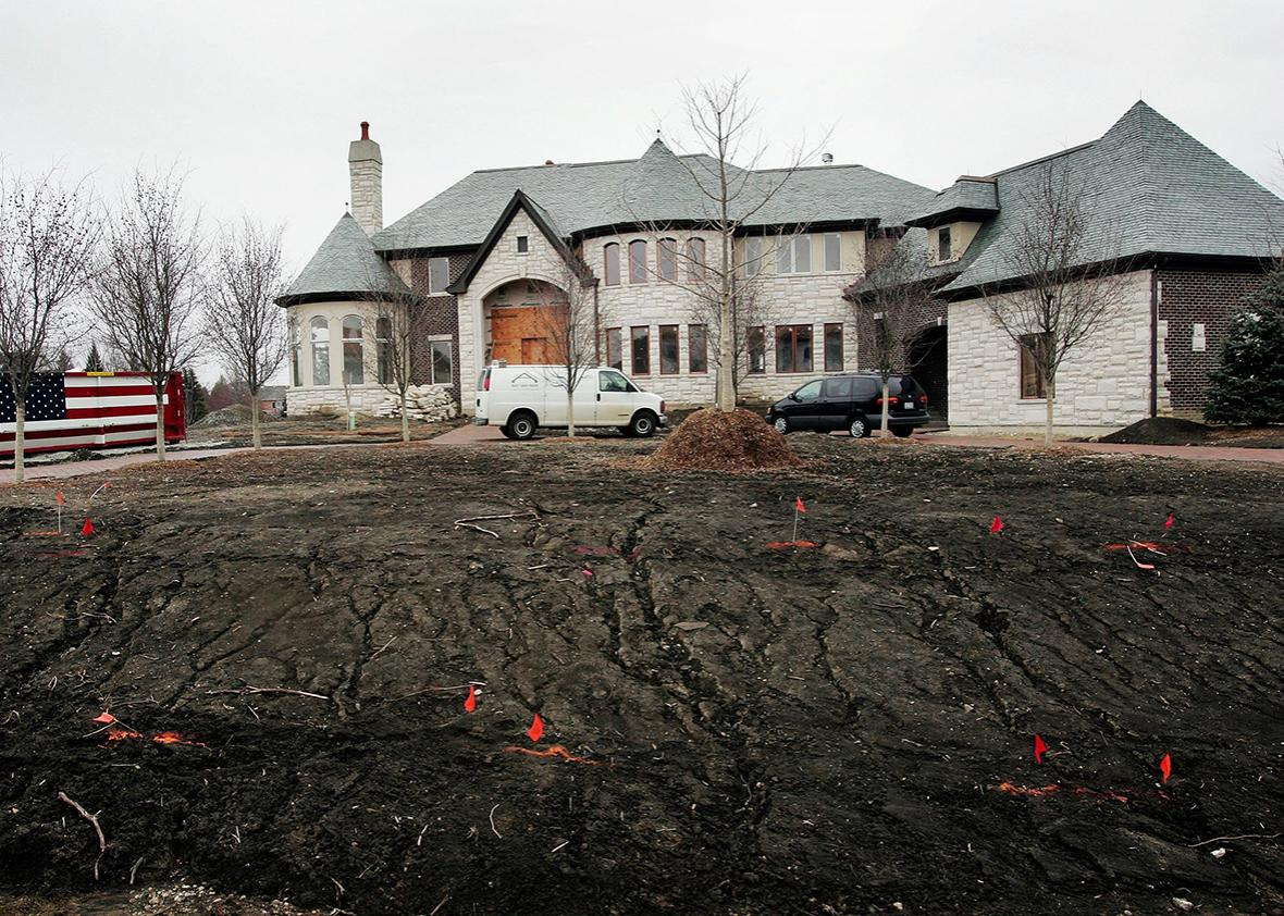 A home stands in the later stages of construction March 24, 2006 in Inverness, Illinois. Nationwide new home sales plummeted more than 10 percent in February to their lowest levels in nine years.