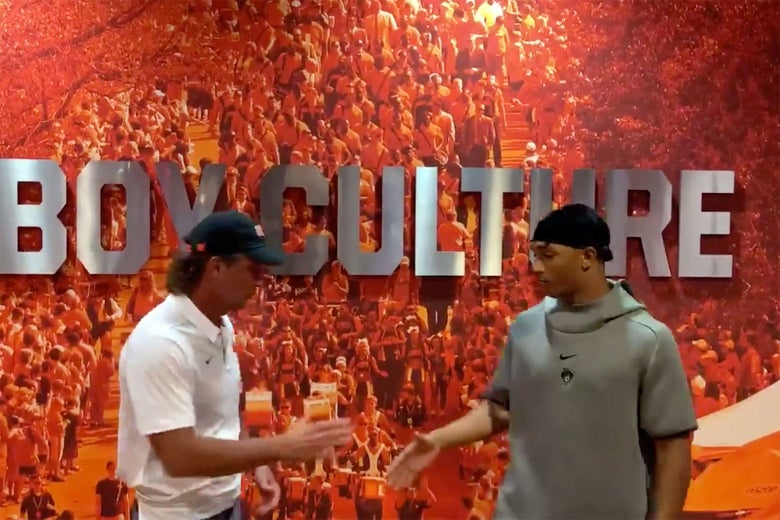 Oklahoma State football coach Mike Gundy shakes hands with player Chuba Hubbard in a video after the two had had a public feud.