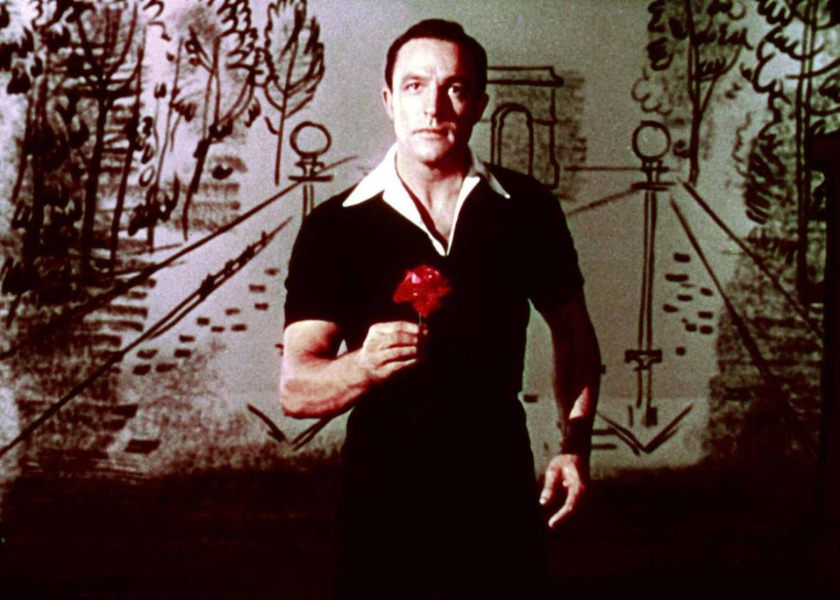 Gene Kelly, in front of a drawing of the Arc de Triomphe, in An American in Paris.