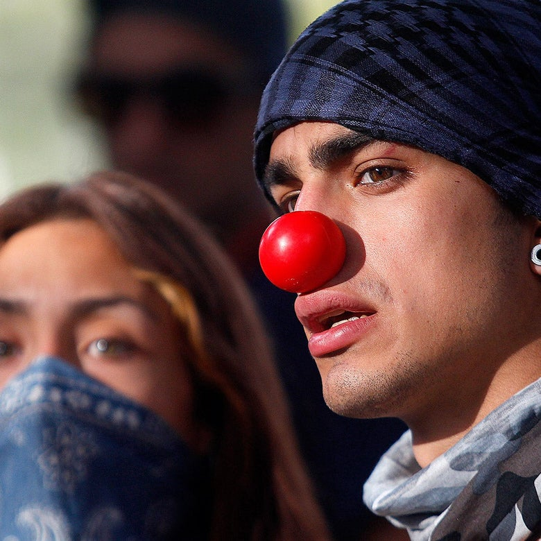 A Chilean protester wearing a clown nose on Tuesday in Santiago.