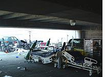 Beds and IV stands in the hospital garage          Click on image to expand