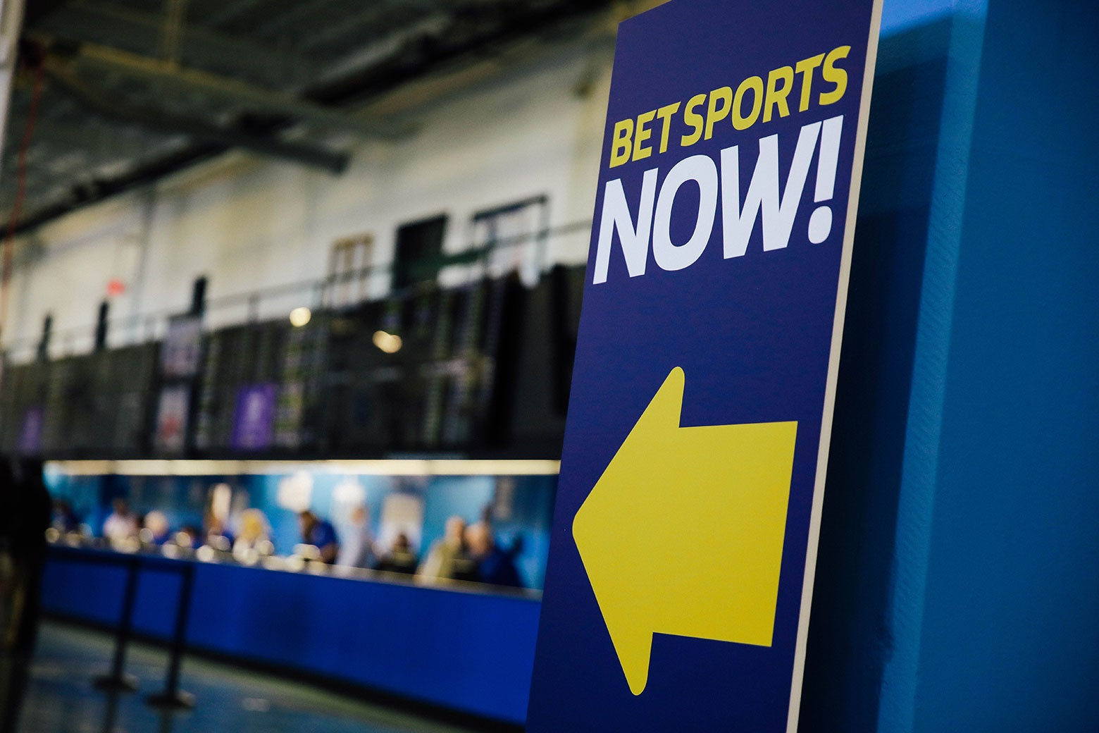 """Bet Sports Now!"" sign at The Monmouth Park Sports Book is viewed on the first day of legal sports betting in New Jersey on June 14."