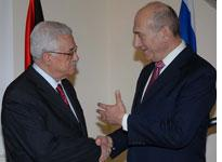 Palestinian leader Mahmoud Abbas meets with Israeli PM Ehud Olmert          Click image to expand.