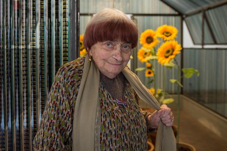 Agnes Varda with a sunflower.