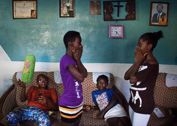 Girls play a clapping game during a weekly education session about breast ironing and rape by survivor of breast ironing Julie Ndjessa at Ndjessa's family home in Douala, Cameroon, November 3, 2013.