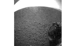 One of the first images taken by NASA's Curiosity rover, which landed on Mars on the evening of August 5, 2012 PDT and transmitted to Spaceflight Operations Facility for NASA's Mars Science Laboratory Curiosity rover at Jet Propulsion Laboratory (JPL) in Pasadena, California.