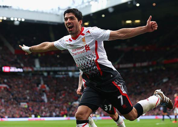 Luis Suarez of Liverpool celebrates scoring his team's third goal.