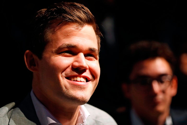 Magnus Carlsen smiles during a press conference after his victory over Fabiano Caruana.
