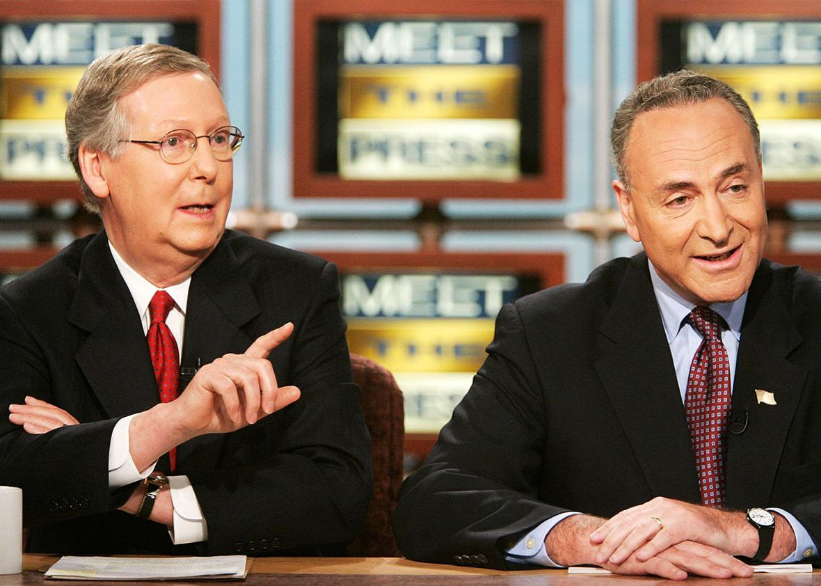 "U.S. Senate Majority Whip Sen. Mitch McConnell speaks as Chairman of Democratic Senatorial Campaign Committee Sen. Charles Schumer listens during a taping of ""Meet the Press"" at the NBC studios July 2, 2006 in Washington, DC."