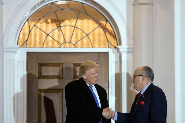 Donald Trump and Rudy Giuliani shake hands a meeting at Trump International Golf Club, November 20, 2016 in Bedminster Township, New Jersey.