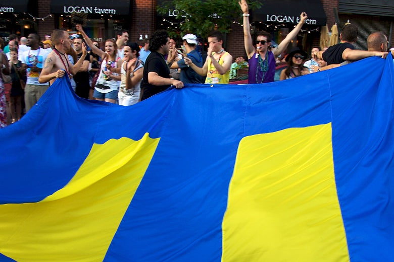 Revelers hold a Human Rights Campaign flag at the 36th Annual Capital Pride celebration in 2011.
