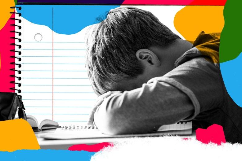A boy puts his head down on his desk.
