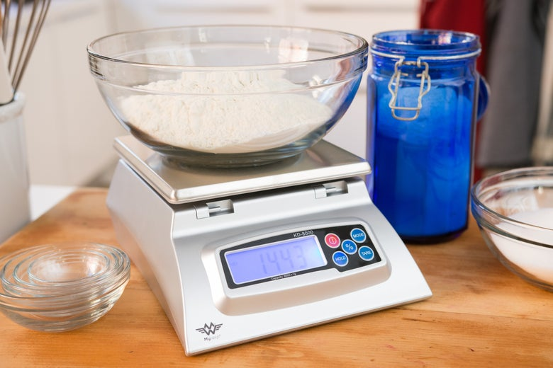 Bowl of flour on the kitchen scale.